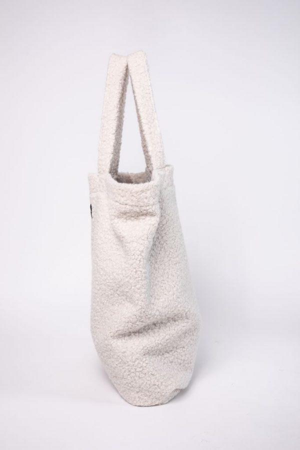 zijkant van de XL tas van teddystof in de kleur wit